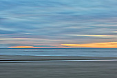 A painting with the camera of a sunset on a cold Winters evening facing west across the Irish sea from the Fylde Coast.