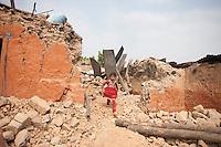 Keshrina, 7, coming down from her destroyed house at Dhulikhel, near Kathmandu, Nepal. May 8, 2015