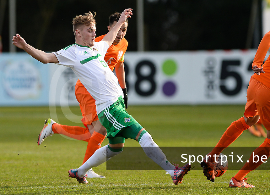 20160326  - Uden , NETHERLANDS : Northern Irish Mark Sykes  pictured during the soccer match between the under 19 teams of The Netherlands and Northern Ireland , on the second matchday in group 4 of the UEFA Under19 Elite rounds in Uden , Netherlands. Saturday 26 th March 2016 . PHOTO DAVID CATRY
