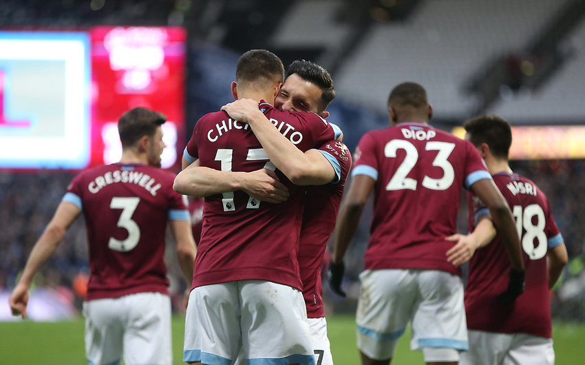 West Ham United's Javier Hernandez celebrates scoring his side's fourth goal with Lucas Perez<br /> <br /> Photographer Rob Newell/CameraSport<br /> <br /> The Premier League - West Ham United v Huddersfield Town - Saturday 16th March 2019 - London Stadium - London<br /> <br /> World Copyright © 2019 CameraSport. All rights reserved. 43 Linden Ave. Countesthorpe. Leicester. England. LE8 5PG - Tel: +44 (0) 116 277 4147 - admin@camerasport.com - www.camerasport.com
