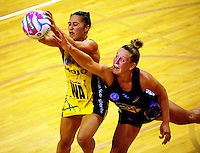 Liana Leota takes a pass under pressure from Jamie-Lee Price during the ANZ Netball Championship match between the Central Pulse and Waikato Bay Of Plenty Magic at TSB Bank Arena, Wellington, New Zealand on Monday, 30 March 2015. Photo: Dave Lintott / lintottphoto.co.nz
