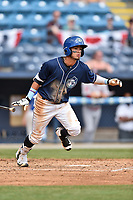Asheville Tourists center fielder Manny Melendez (19) swings at a pitch during a game against the Greenville Drive at McCormick Field on April 16, 2017 in Asheville, North Carolina. The Drive defeated the Tourists 4-2. (Tony Farlow/Four Seam Images)