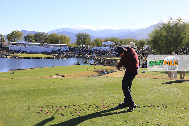 Phil Mickelson (USA) tees off the par3 17th tee during Saturday's Round 3 of the 2017 CareerBuilder Challenge held at PGA West, La Quinta, Palm Springs, California, USA.<br /> 21st January 2017.<br /> Picture: Eoin Clarke | Golffile<br /> <br /> <br /> All photos usage must carry mandatory copyright credit (&copy; Golffile | Eoin Clarke)