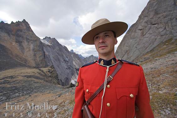 Mountie dressed in RCMP Red Serge in the Tombstone Mountains, Yukon