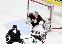 UNO's Matt White lifts a backhander over the glove of St. Cloud State goalie Mike Lee during the third period. UNO rallied from a 3-0 deficit to beat St. Cloud State 4-3 Saturday night at Qwest Center Omaha.  (Photo by Michelle Bishop)