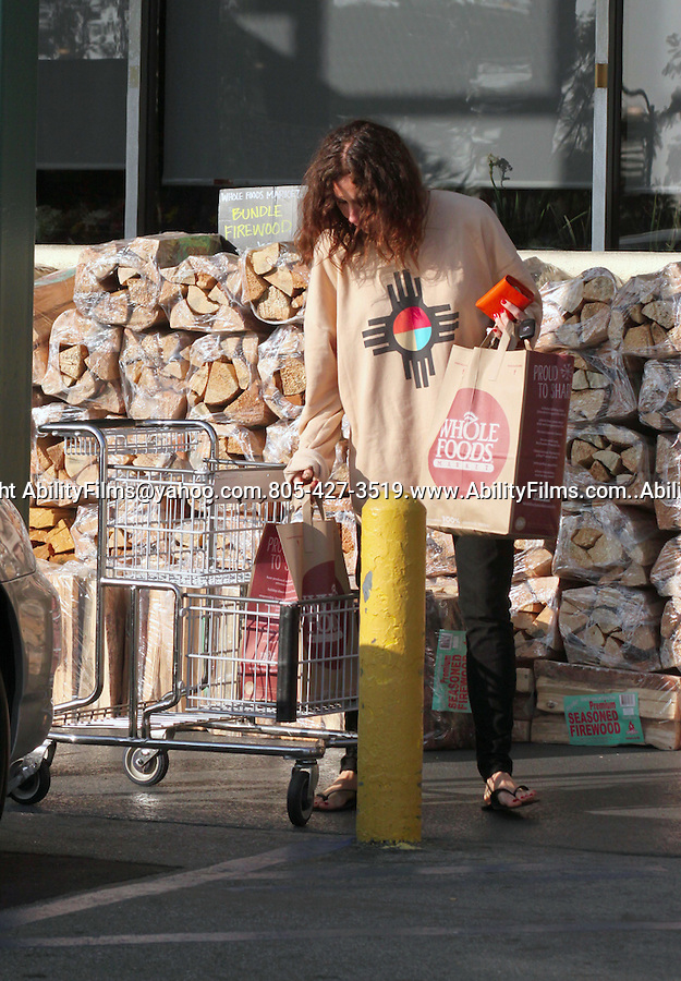 .January 2nd 2012  Exclusive ...Minnie Driver wearing a blue & red circle Native American Indian design on her tan sweater carrying two grocery bags from Whole Foods in West Hollywood California..AbilityFilms@yahoo.com.805-427-3519.www.AbilityFilms.com....