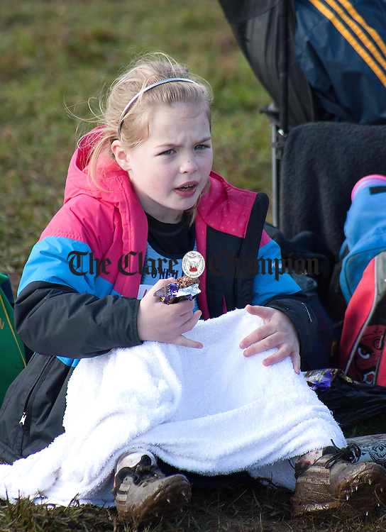 041112.7 year old Alannah Attewell, St Marys, takes a chocolate break at Kilnaboy Cross Country on Sunday.