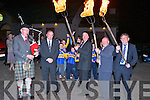 Maurice Costello, Domo O'Ciardubhain and Mike Flynn light up the turf for the march through the village on Thursday night for GAA President Liam O'Neill