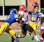 BROOKINGS, SD - OCTOBER 25:  Melvin Tavaras #1 from South Dakota State University applies pressure as Andre Stubbs #4 from Youngstown State can't catch the pass in the second quarter of their game Saturday afternoon at Coughlin Alumni Stadium in Brookings. (Photo by Dave Eggen/Inertia)