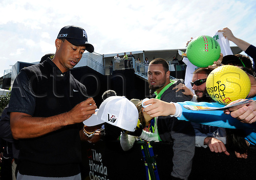 02.03.2013 Florida, USA. Tiger Woods signs autographs for the fans after completing the third round of the Honda Classic at the PGA National Resort & Spa in Palm Beach Gardens, FL.