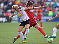 Portland, Oregon - Sunday October 2, 2016: Western New York Flash midfielder McCall Zerboni (7) and Portland Thorns FC forward Nadia Nadim (9) fight for the ball during a semi final match of the National Women's Soccer League (NWSL) at Providence Park.