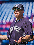 11 March 2014: New York Yankees Manager Joe Girardi watches batting practice prior to a Spring Training game against the Washington Nationals at Space Coast Stadium in Viera, Florida. The Nationals defeated the Yankees 3-2 in Grapefruit League play. Mandatory Credit: Ed Wolfstein Photo *** RAW (NEF) Image File Available ***
