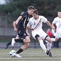 Brown University midfielder Bobby Belair (10) attempts to control the ball as Boston College defender Nick Corliss (5) defends. Brown University (black) defeated Boston College (white), 1-0, at Newton Campus Field, October 16, 2012.