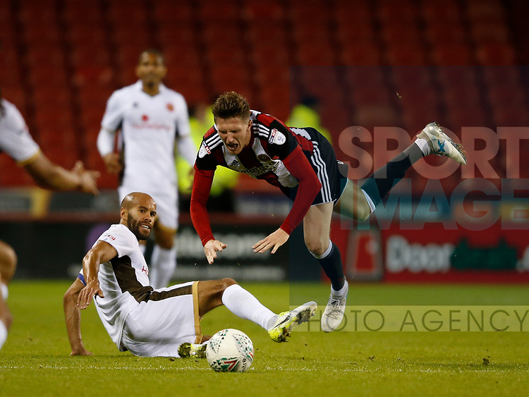Adam Chambers of Walsall brings down John Lundstram of Sheffield Utd  during the Carabao Cup First Round match at Bramall Lane Stadium, Sheffield. Picture date: August 9th 2017. Pic credit should read: Simon Bellis/Sportimage
