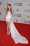 LOS ANGELES, CA. - November 21: Miley Cyrus arrives at the 2010 American Music Awards held at Nokia Theatre L.A. Live on November 21, 2010 in Los Angeles, California.