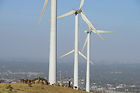 KENYA, Nairobi, Ngong Hills, 25,5 MW Wind Power Station with Vestas and Gamesa wind turbines, owned and operated by KENGEN Kenya Electricity Generating Company, shepherd with sheeps,  view to Nairobi / KENIA, Ngong Hills Windpark, Betreiber KenGen Kenya Electricity Generating Company mit Vestas und Gamesa Windkraftanlagen, junger Hirte mit Schafen, Blick nach Nairobi