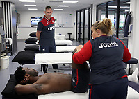 Pictured: Wilfried Bony speaks with manager Paul Clement during his medical with club physiotherapist Kate Rees at the Fairwood Training Ground, Wales, UK. Thursday 31 August 2017<br /> Re: Wilfried Bony has signed a contract with Swansea City FC.
