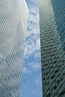 Upward View of Office Buildings and Clouds in Midtown Manhattan, New York City, New York State, USA<br /> <br /> AVAILABLE FOR LICENSING FROM GETTY IMAGES.  Please go to www.gettyimages.com and search for image # 162293658.