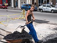 Filling potholes, Centro Habana