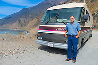 Old man near his old fashioned Pace Arrow RV in Big Sur, California