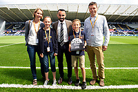 Todays match ball sponsors with Leon Britton prior to the Sky Bet Championship match between Swansea City and Bristol City at the Liberty Stadium, Swansea, Wales, UK. Saturday 25 August 2018