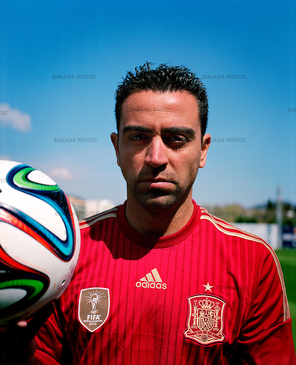 Xavi Hernandez, Catalan and Spanish football player of FC Barcelona, on Spanish selection Uniform with an official ball of FIFA World Cup 2014.