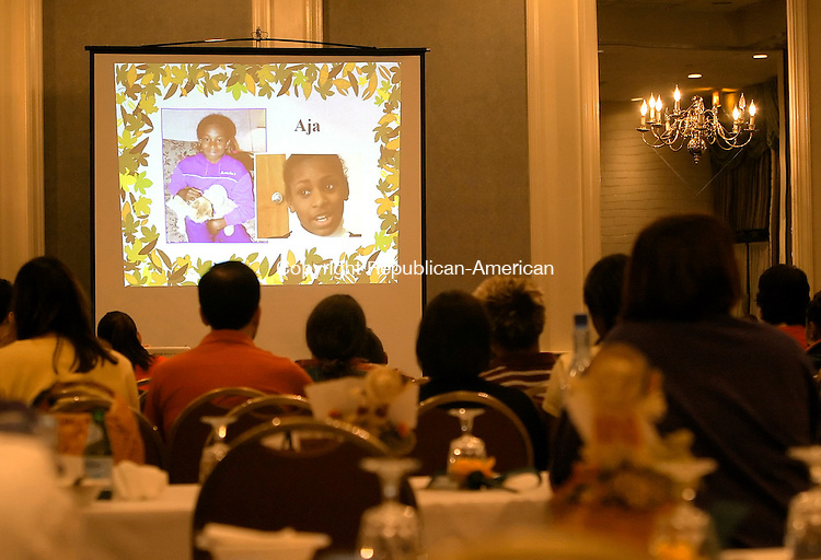 WATERBURY, CT - 22 September 2005 -092205JS07--Prospective parents watch video's on children in need of adaption during the DCF's fall adoption gala Thursday at the Grand Hotel in Waterbury.    --Jim Shannon / Republican-American  --Grand Hotel; Waterbury;  are CQ