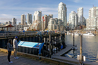 Granville island waterfront with Creek and downtown condominium towers in back, Vancouver, British Columbia, Canada