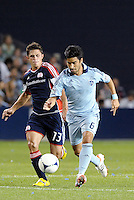 Paulo Nagamura, (6) Sporting KC moves past Ryan Guy New England... Sporting Kansas City defeated New England Revolution 3-0 at LIVESTRONG Sporting Park, Kansas City, Kansas.