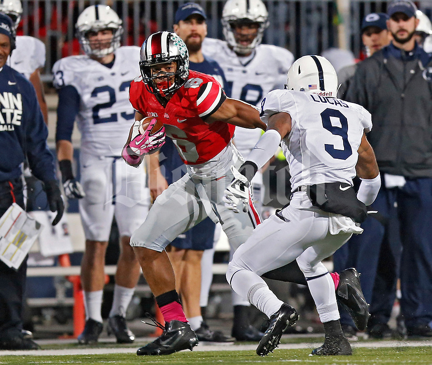 Ohio State Buckeyes wide receiver Evan Spencer (6) makes a catch against Penn State Nittany Lions cornerback Jordan Lucas (9) in the 2nd quarter at Ohio Stadium on October 26, 2013.  (Dispatch photo by Kyle Robertson)