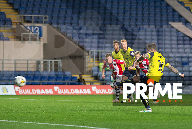 Chris Maguire of Oxford United scores from the penalty spot during the The Checkatrade Trophy match between Oxford United and Exeter City at the Kassam Stadium, Oxford, England on 30 August 2016. Photo by Andy Rowland / PRiME Media Images.