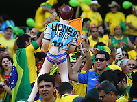 Brazil fans hold a blow up doll wearing an Argentina shirt with the name of Lionel Messi and women's underwear