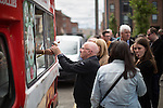 © Joel Goodman - 07973 332324 . 30/07/2016 . Liverpool , UK . People queue for free ice creams , provided by the Owen Smith campaign at a rally . The event was redirected to a field off Bridgewater Street in Liverpool when the booked venue , the Camp and Furnace warehouse , reportedly cancelled the booking . Smith is campaigning to replace Jeremy Corbyn as the leader of the Labour Party . Photo credit : Joel Goodman