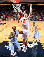 Virginia forward/center Mike Tobey (10) shoots next to North Carolina forward Joel James (42) during an NCAA basketball game against Virginia Monday Jan. 20, 2014 in Charlottesville, VA. Virginia defeated North Carolina 76-61.