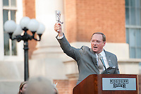 The Drill Pep Rally - President Keenum demonstrates how to ring responsibly - The Drill Field<br />  (photo by Megan Bean / &copy; Mississippi State University)