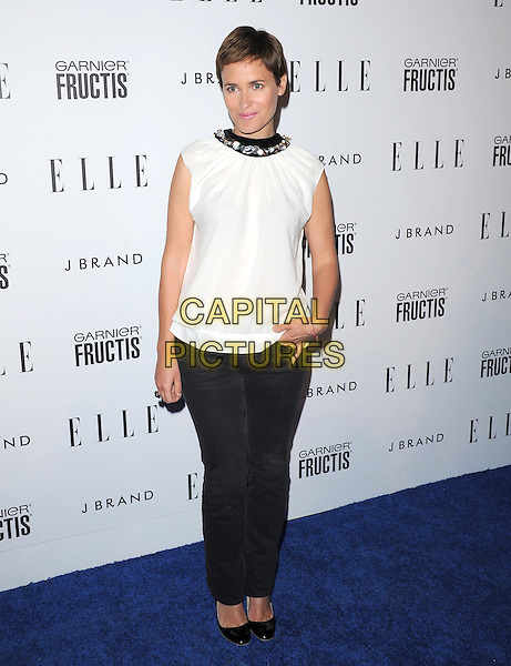 JUDITH GODRECHE.The ELLE Women in Music Event held at The Music Box in Hollywood, California, USA. .April 11th, 2011.full length top trousers black white sleeveless collar beads embellished .CAP/RKE/DVS.©DVS/RockinExposures/Capital Pictures.
