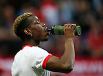 Paul Pogba of Manchester United takes on liquid during the UEFA Europa League Final match at the Friends Arena, Stockholm. Picture date: May 24th, 2017.Picture credit should read: Matt McNulty/Sportimage