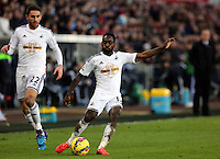 SWANSEA, WALES - FEBRUARY 07: Nathan Dyer of Swansea takes a shot during the Premier League match between Swansea City and Sunderland AFC at Liberty Stadium on February 7, 2015 in Swansea, Wales.