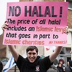 © Joel Goodman - 07973 332324 .  07/02/2015 . Dudley , UK . Supporter with NO HALAL sign . Approximately 500 EDL supporters at an English Defence League demonstration in Dudley , in the West Midlands , this afternoon ( Saturday 7th February 2015 ). Photo credit : Joel Goodman