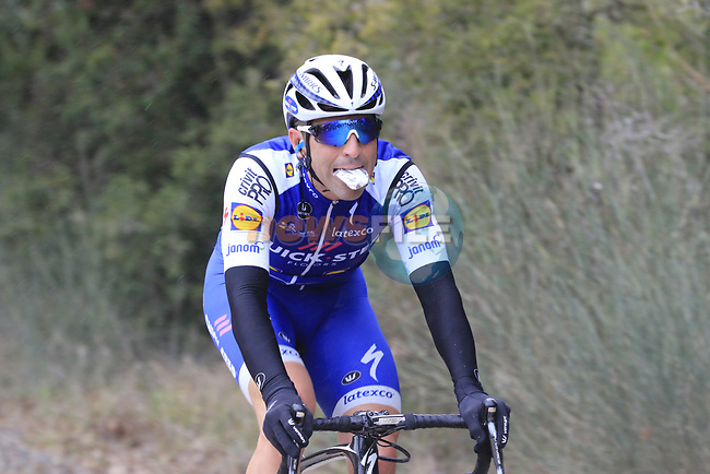 Time for a snack Maximiliano Ariel Richeze (ARG) Quick-Step Floors on gravel sector 3 Radi during the 2017 Strade Bianche running 175km from Siena to Siena, Tuscany, Italy 4th March 2017.<br /> Picture: Eoin Clarke | Newsfile<br /> <br /> <br /> All photos usage must carry mandatory copyright credit (&copy; Newsfile | Eoin Clarke)