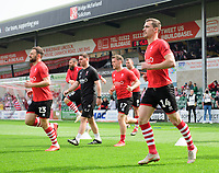 Lincoln City's Neal Eardley, left, and Lincoln City's Harry Toffolo during the pre-match warm-up<br /> <br /> Photographer Chris Vaughan/CameraSport<br /> <br /> The EFL Sky Bet League Two - Lincoln City v Tranmere Rovers - Monday 22nd April 2019 - Sincil Bank - Lincoln<br /> <br /> World Copyright © 2019 CameraSport. All rights reserved. 43 Linden Ave. Countesthorpe. Leicester. England. LE8 5PG - Tel: +44 (0) 116 277 4147 - admin@camerasport.com - www.camerasport.com