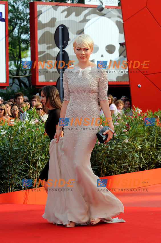 """- """"67 Mostra Internazionale D'Arte Cinematografica"""". Sunday, 2010 September 05, Venice ITALY..- In The Picture: The actress Michelle Williams on the red carpet for the premiere of the film  """"MEEK'S CUTOFF""""...Photo STEFANO MICOZZI / Insidefoto"""