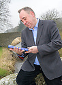 Former First Minister Alex Salmond with his new book at his home in Strichen.
