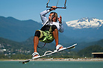July 21, 2009.  Kiteboard instructor Patrick Hebbget gets some big air while kiteboarding at the Spit in Squamish, BC, Canada.  Photo by Gus Curtis.