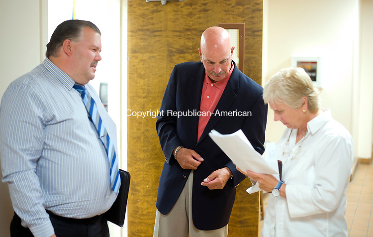 WINSTED, CT-0712017JS22--Developer Brian Lyman with Parker Benjamin Real Estate Services, center, talks with Winsted Mayor Candy Perez, right and Selectman Todd Arcelaschi, left, following a special town meeting on Thursday. During the meeting, taxpayers voted unanimously to sell the former Lambert Kay pet supply factory to Lyman for $1000.  <br /> Jim Shannon Republican-American