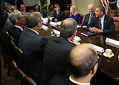 United States President Barack Obama (R) and Vice President Joe Biden (2R) meet with executives from leading technology companies, including Apple, Twitter, and Google in the Roosevelt Room of the White House on December 17, 2913 in Washington, DC. The White House said the meeting focused on efforts to repair administration's troubled HealthCare.gov website. <br /> Credit: Mark Wilson / Pool via CNP