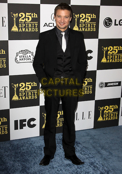 JEREMEY RENNER .25th Annual Film Independent Spirit Awards held At The Nokia LA Live, Los Angeles, California, USA,.March 5th, 2010 ..arrivals Indie Spirit full length black suit tie waistcoat white silver hands in pockets .CAP/ADM/KB.©Kevan Brooks/Admedia/Capital Pictures
