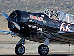 Vic McMann taxis in his AT-6A plane called Gunslinger during the National Championship Air Races at the Reno-Stead Airfield Friday, Sept. 18, 2015.