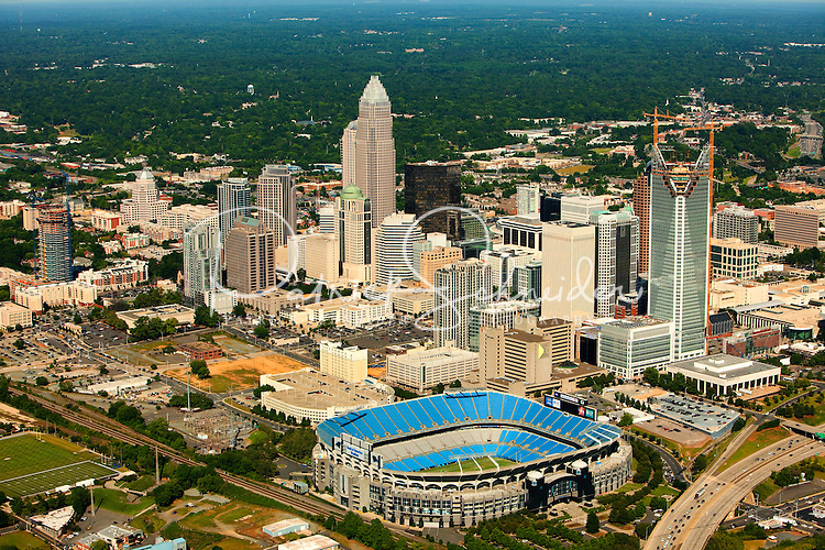 Aerial photography over Charlotte, NC, and the surrounding areas from May 2009. Photos by Charlotte photographer Patrick Schneider Photography. Photo of the Charlotte skyline and downtown Charlotte, NC. Bank of America stadium, home of the Carolina Panthers, is in the foreground.
