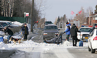 Jason Barron crosses 15th Avenue in Anchorage on Saturday March 1st during the ceremonial start day of the 2008 Iidtarod Sled Dog Race.  Police officers stop traffic to let the teams by.